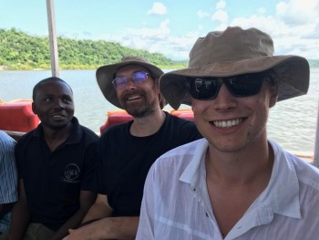 (Figure 4. Severin-left, Graham-middle and myself-right on a chain ferry across the river of Pangani)