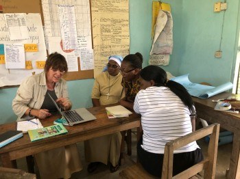 Patricia looking at Activity Sheets with teachers from Pangani Primary School