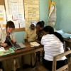 Education officer working with school staff